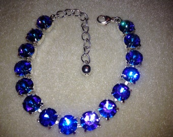 Swarovski Heliotrope braclet with extension and lobster clasp, beautiful blues and purples crystals hand set