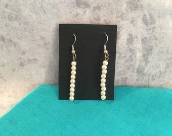White imitation pearl earrings