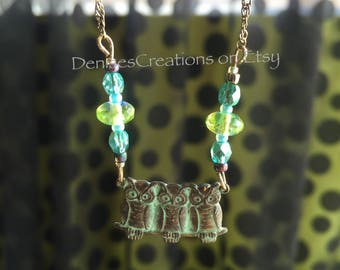 Patina Owls on a Perch Necklace with Ocean, Teal, Blue and Peridot Green Czech Fire Polished Glass Beads by Denise Sloan