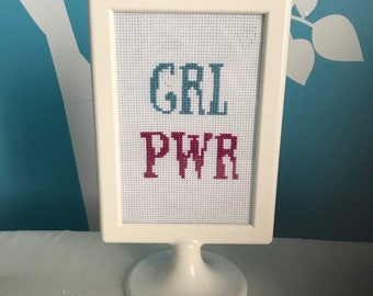 GRL PWR cross stitch framed in a frame finished piece