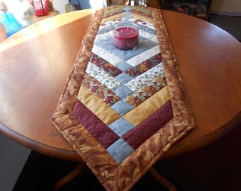 Woodsy table runners in browns, greens, blues, burgandy printed cotton fabric, 14.5 inches wide 49 and 54 inches long, hand quilted.