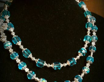 Aqua crystal with side cross