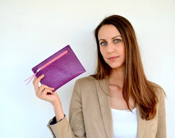 Croco style purple leather pouch with zipper in front