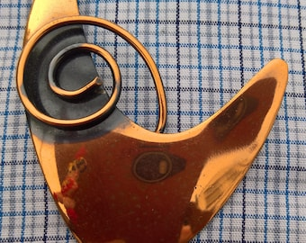 copper vintage brooch with a swirl