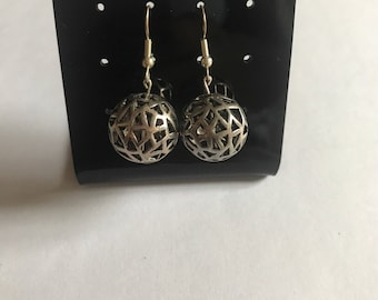 Silver Round 'Cut Out' Earrings.