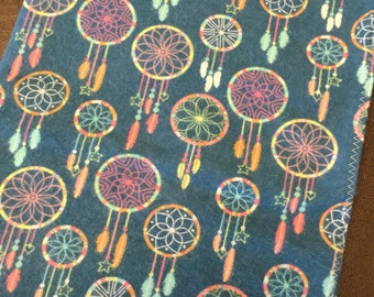 Teal flannel receiving blanket  with multi  colored dream catcher print
