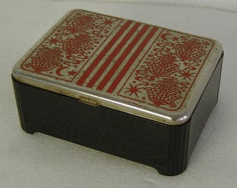Art Deco bakelite and chrome trinket box with red incised pattern