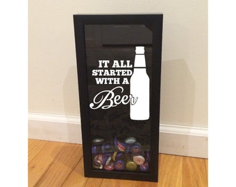 """Bottle Cap Holder Shadow Box - It All Started With A Beer - Black (6"""" x 14"""") - Vinyl Decal Gifts, Home Bar Accessories"""