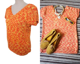 Space dye orange and yellow vintage knit top. V  front and back neckline. Cap sleeve.