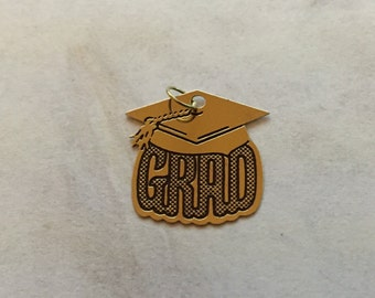 14 Karat gold GRAD charm for Graduation celebrate with this keepsake gift