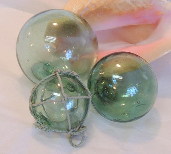 3 unique Vintage Japanese GLASS FISHING FLOATS Varian Sizes & Colors.. One With Net (#44)