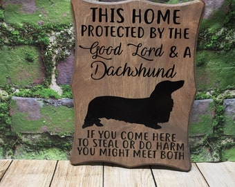 This home protected by the good lord and a dachshund