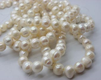 38 has 39 about pearls natural 10-11 mm mm ivory white Baroque