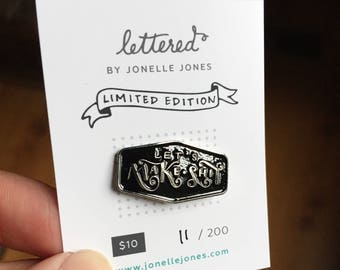 LIMITED EDITION Black and Silver Let's Make Shit Collector's Enamel Pin. Maker flare for your maker apron or denim jacket. Soft enamel.