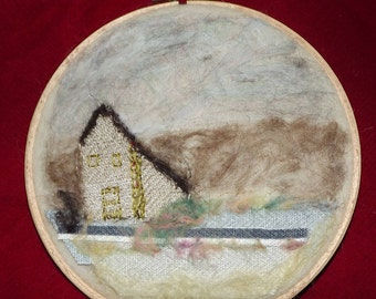Handmade needle felt and stitched picture in a hoop frame titled Windy Day