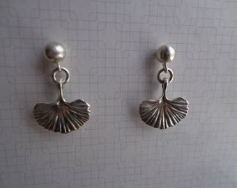 Silver earrings with ear post.