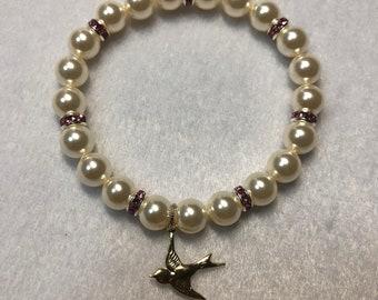 Swallow charm with Swarovski pearls