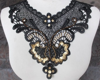 Cute  beaded   applique  with  sequins   black color 1 pieces listing 7 1/2 inches wide at the neck 3 inches wide at the shoulder