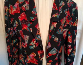 Vintage Fendi Jacket. Eccentric art print on black wool. Fully lined with black taffeta. Lapel front and collar. As new.