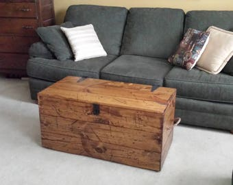 Rustic Vintage Coffee Table Trunk: Distressed custom coffee table doubles as storage trunk, hope chest, or unique showpiece.
