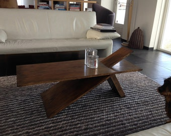 Coffee table with hanging sheet