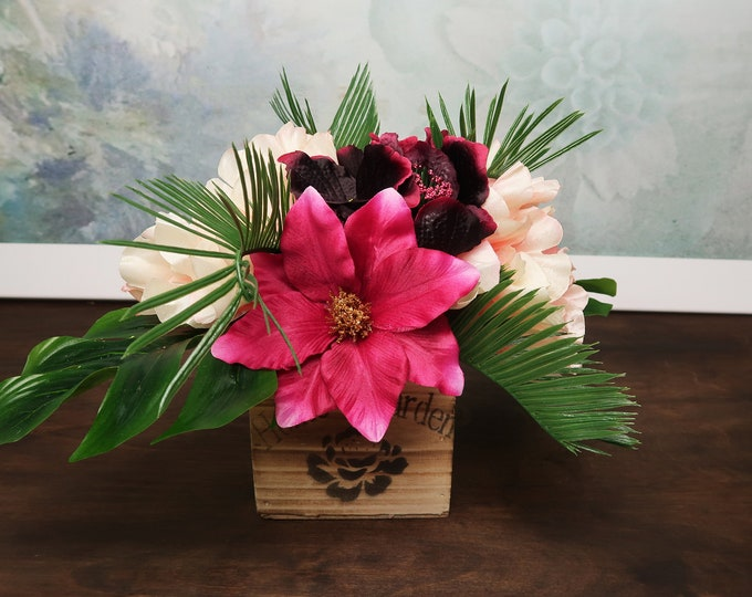 Burgundy, fuchsia and peach tropical wedding centerpiece