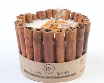Candle with orange & cinnamon fragrance with long cinnamon sticks