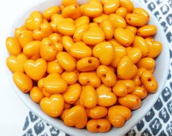 100x 10mm Darker Orange Heart Shaped Beads