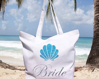 Beach bride white 100% organic cotton bag with glitter writing and blue glitter shell. Very sparkling!