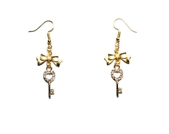 "Gold colored ""Rhinestones key"" earrings"