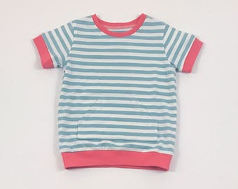 Blue Stripes Shirt. Boys Tee Shirt. Organic Cotton Shirt. Jersey Knit Tee Shirt. Canguru Pocket. Boy Tee. Coral Cuffed Sleeve. Short Sleeve.