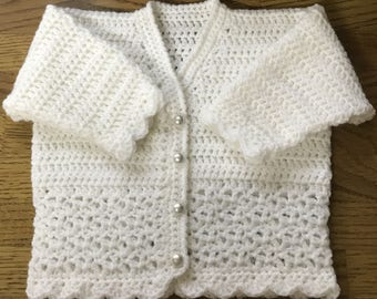 Printed Baby Crochet Pattern in DK. (Made in one piece to armholes) Sizes Birth to 6 years (1028)