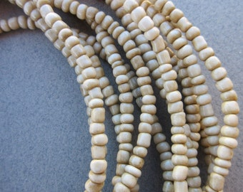 White Goomba Beads -6 Strands