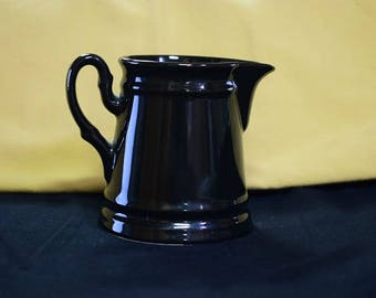 Gloss black ceramic Pouring vessel, very clean.