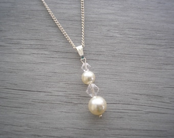 Stunning Pendant Necklace made with Swarovski 8 & 6mm Pearls and 6 and 4mm Crystals on a fine silver plated chain 9CSWN