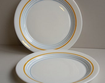 White Pyrex side plates with orange/blue trim