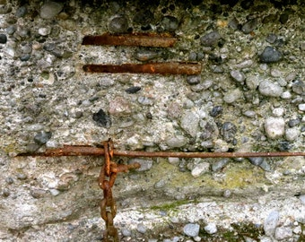 Old Silo Rebar Reinforcements, Rusty Chain and Stone Macro