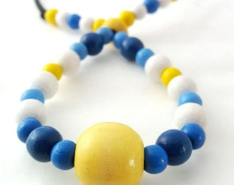 Fiddle necklace, babywearing necklace, nursing necklace, breastfeeding beaded necklace, unique, blue white and yellow