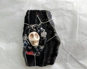 Where The Skulls Are wire-wrapped black agate pendant
