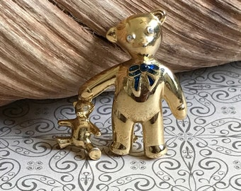 Gold tone teddy bear carrying baby bear brooch