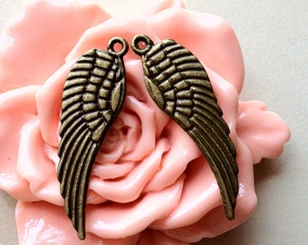 30 x 10 mm Medium Size Antique Bronze Angel Wing Charms (.tn)