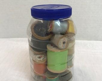 Quart Jar Full of Wood Thread Spools - 26 Spools