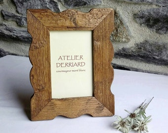 Picture frame shaped in old wood, table or wall