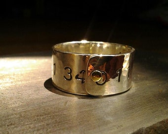 3/8 inch wide riveted sterling silver band stamped with Fibonacci sequence