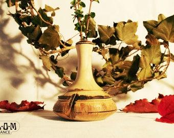 Charming gnarled wood vase