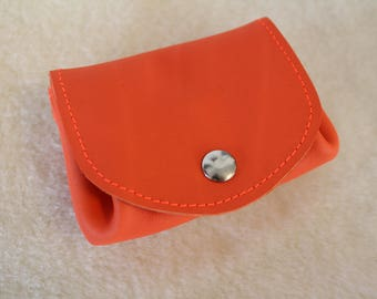 orange leather wallet. wallet; leather wallet. bright orange coin purse