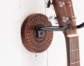 Guitar Wall Mount. Etch wood guitar hanger of mandala design and hand forged steel holder
