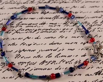 Red, white, and blue ankle bracelet with a silver star toggle