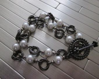White pearl beads and gunmetal rosebud metal links....gunmetal toggle clasp.