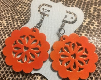Handmade filigreed leather concho earrings